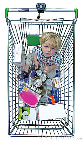 Young boy in shopping trolley