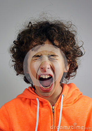Young boy is shouting