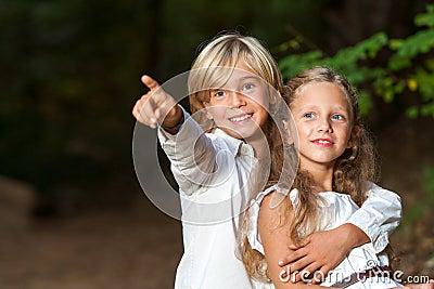 Young boy showing girlfriend the way.