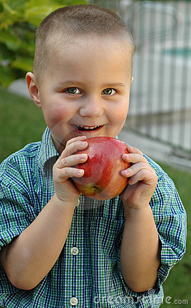 Young boy snacking on a juicy