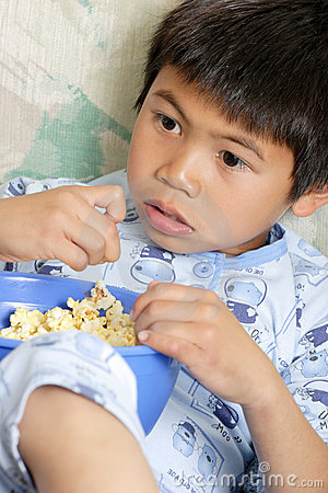Free Young Boy Snacking On Popcorn Royalty Free Stock Photography - 541847