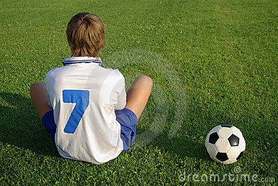 A young boy with a soccer ball
