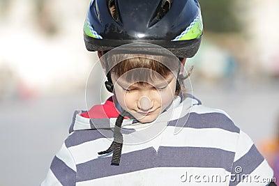 Young boy in sport helmet