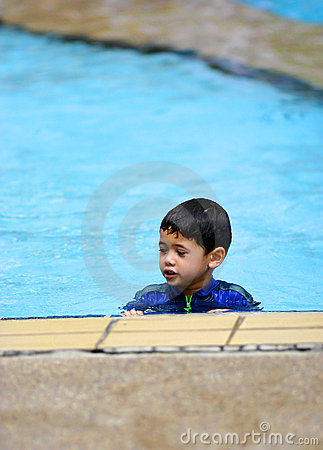 A young boy in  a swimming pool