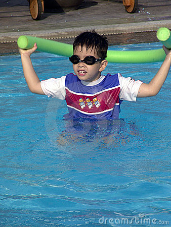 Young boy in the swimming-pool