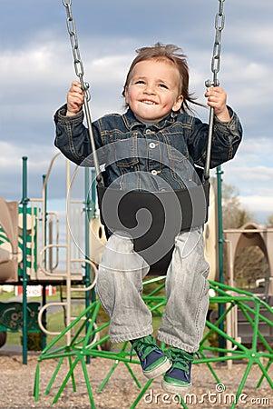 Young Boy Swinging