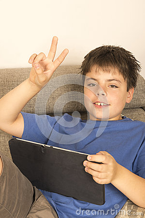 Young boy and a tablet digital