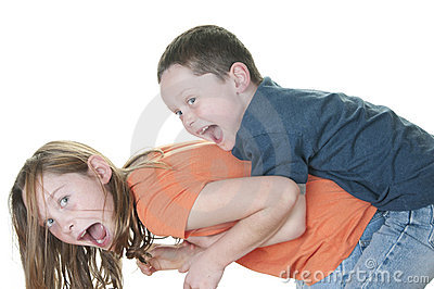 Young boy tackling girl