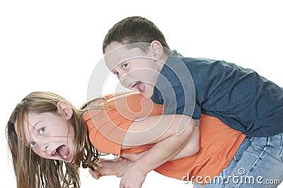 Young boy tackling girl
