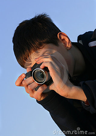 Young boy taking photos