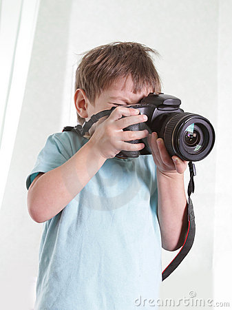 Free Young Boy Taking Picture Stock Photos - 23132103