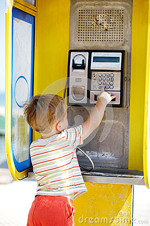 Free Young Boy Talking To The Phone In A Booth Royalty Free Stock Photography - 37124307