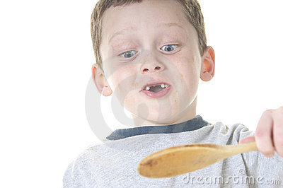 Young boy tasting food