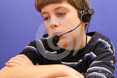 Young boy on telephone blue background