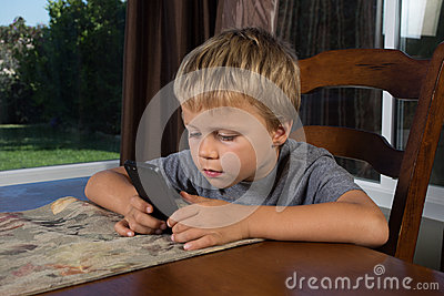 Young Boy Texting on Phone
