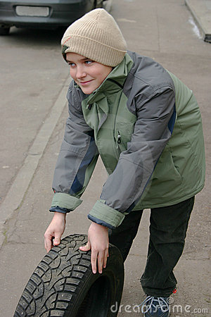 Young Boy With Tire