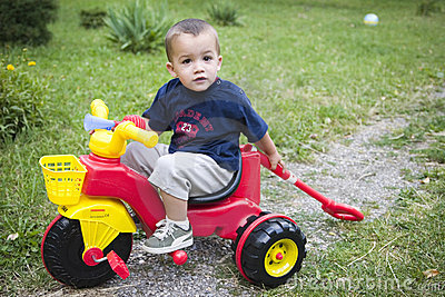 Young boy on toy bike