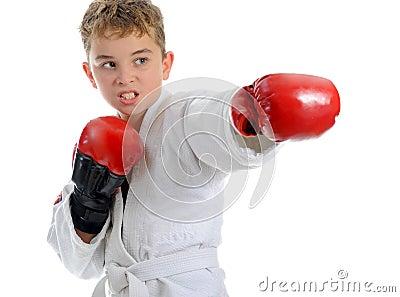 Young boy training karate.