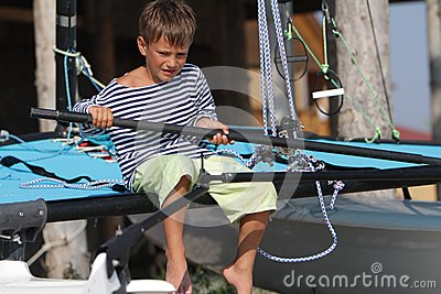 Young boy traveling on yacht