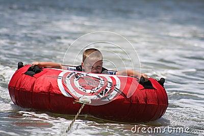 Young boy tubing