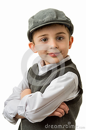 Young boy with vest and flat cap