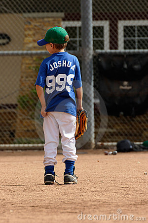 Young boy waiting for play in baseball