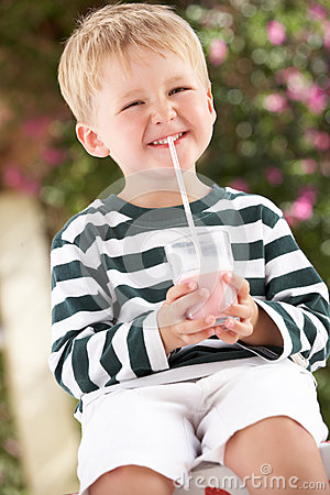 Young Boy Wearing Boots With Milkshake