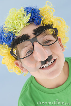 Free Young Boy Wearing Clown Wig And Fake Nose Royalty Free Stock Photos - 5946148