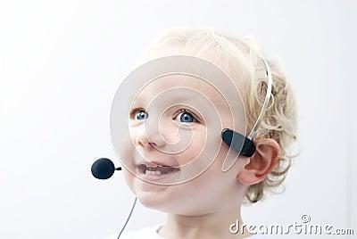 Young boy wearing phone headset