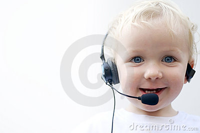 Young boy wearing phone headset