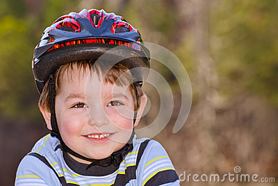 Young boy wearing safety helmet