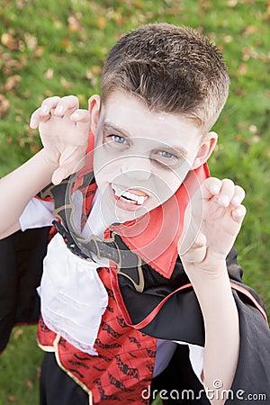Young boy wearing vampire costume on Halloween