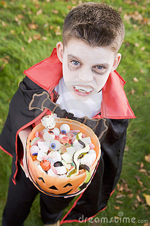Young boy wearing vampire costume on Halloween