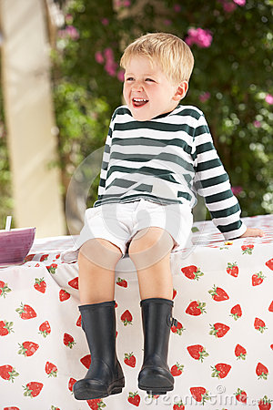 Young Boy Wearing Wellington Boots