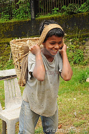 Young Boy works hard as porter, India Editorial Stock Photo