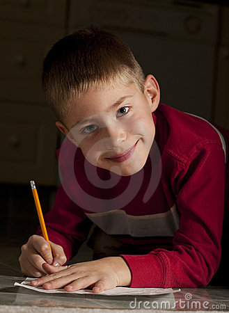 Young boy writing