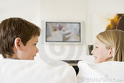 Young boy and young girl in living room