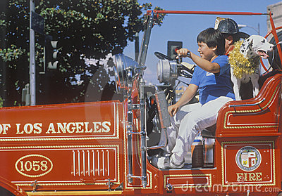 Young boys and dog in historic fire truck Editorial Stock Image