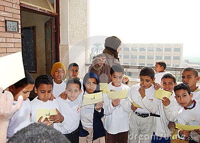 Young boys playing words game at school