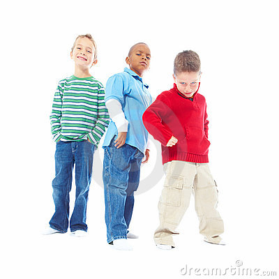 Young boys posing against white background