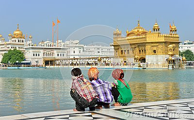 Young Boys Squatting in Golden Temple, Amritsar Editorial Stock Image