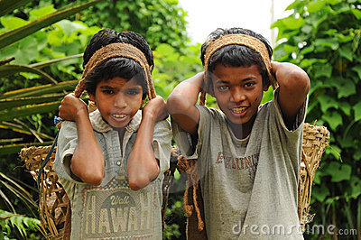 Young Boys work hard as porters, India Editorial Stock Photo