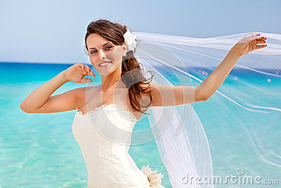 Young bride and blue sea