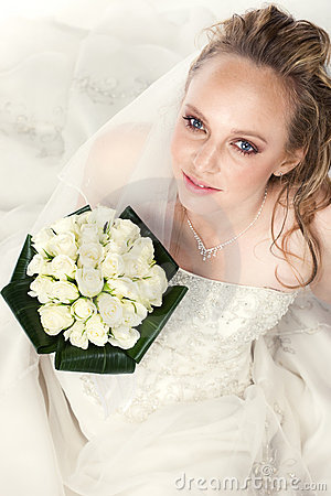 Young bride with bouquet of roses
