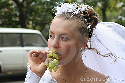Young bride with grape