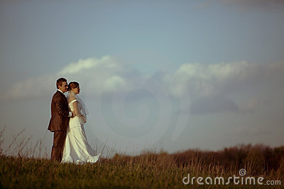 Young bride groom against blue sky clouds