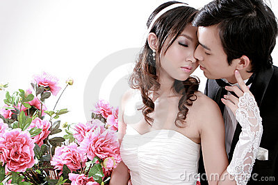 Young bride and groom kissing each other