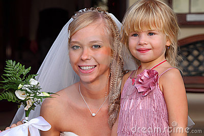 Young bride and little girl smile