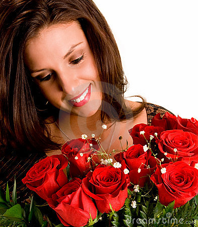 Young Brunette Admiring her Roses
