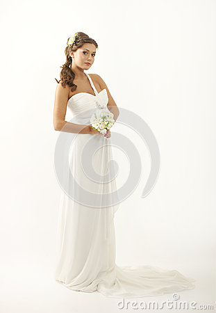 A young brunette bride in a beautiful white dress